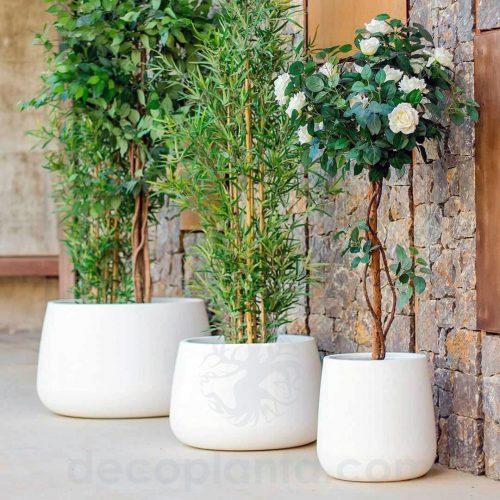 Jardinera DECOLUXE redonda, fabricada en resina de alta resistencia